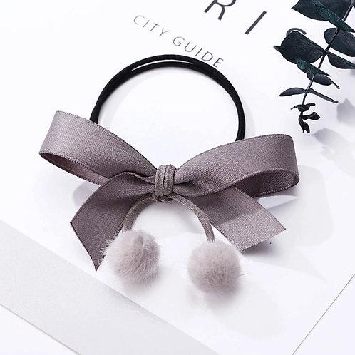 La petite surprise Couture Haargummi Schleife Grau