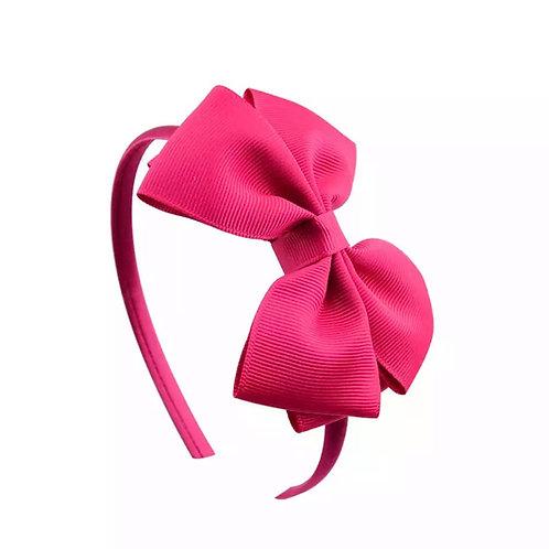 La petite surprise Couture Haarreifen Schleife Fuchsia