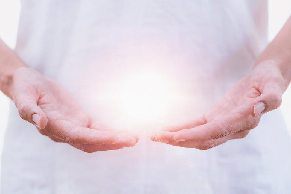 Close up horizontal image of distance healing hands of therapist at Reiki healing treatmen...ept.jpg
