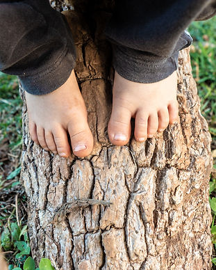 Close up of barefoot dirty child feet pl