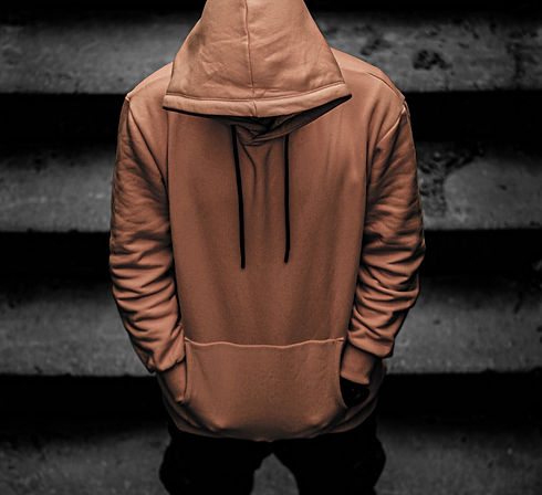 person%20in%20brown%20hoodie%20and%20black%20pants%20standing%20on%20staircase_edited.jpg