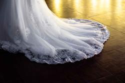 A stunning wedding dress gliding along the dance floor