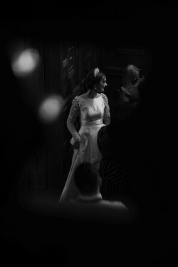A black and white portrait of the happy bride at Eynsham Hall