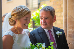 Father of the bride and bride having a laugh before she is given away at The Oratory Oxford