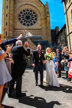 Bide and Groom leaving the Oxford Oratory through a cloud of confetti