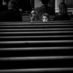 A flower girl waits for the bride to arrive at The Oxford Oratory