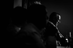 Black and white shot of the best man waiting to give his speech