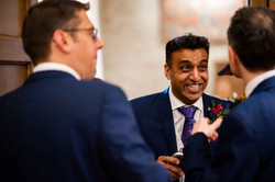 Groomsman having a laugh with the best man and groom at The Great Barn Aynho