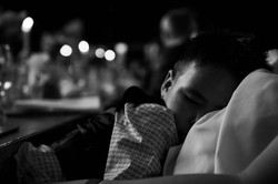 Pageboy sleeping on his mummy at Wadham College