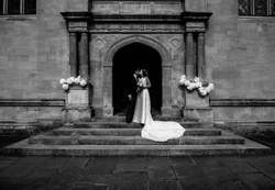 A little kiss on the steps of Wadham College Oxford