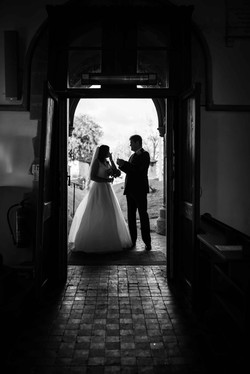 Silhouette of the bride and her father enetering the church