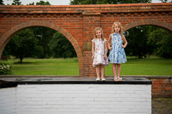 The tow flower girls pose at Milton Hill House