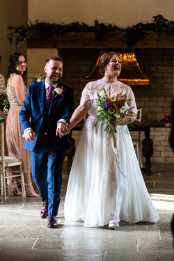 We are married, yay, Bride and groom walking down the aisle at Blackwell Grange