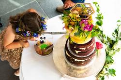 Flower girl kissing the cake at Blackwell Grange