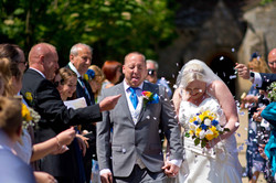 Groom gets a Mouth full of confetti
