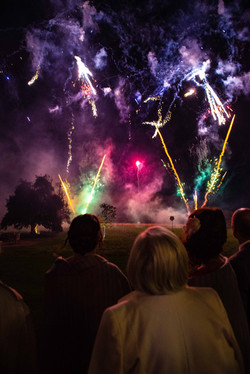 Bride and groom watch the firework display at Elmore Court