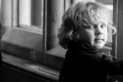 Black and white portrait of the pageboy at Eynsham Hall