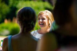 Happy bride chatting to her bridesmaids at Trinity College