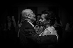 Black and white portrait of the happy couple dancing
