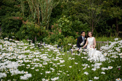 Bride and groom sitting together at Wadham College