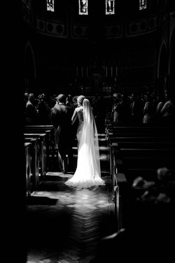 A father walking his daughter down the aisle at the Oxford Oratory