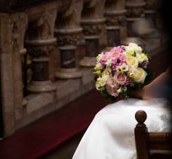 A bride holds her stunning bouquet by Flowers By Kirsty at the Oxford Oratory