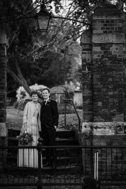 Black and white shot of the bride and groom