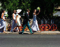 Wedding party walking through Oxford to get to the wedding breakfast