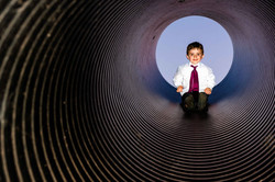 Cheeky pageboy slides down the slide