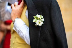The grooms buttonhole by flowers by Kirsty at the stunning Trinity College