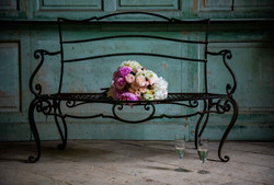 A bouquet sits on bench at Kingston Bagpuize House