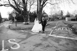Black and white shot of the beautiful bride and groom at a junction.