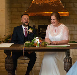 Bride and Groom signing the registry at Blackwell Grange