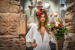 A bride wearing Ellie Sanderson dress with a Flowers by Kirsty bouquet at The Ashmolean Museum.