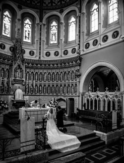 Stunning shot of the brides dress flowing down the steps of The Oratory in Oxford