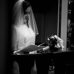 Stunning black and white image of a bride at the alter