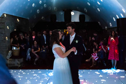 The guests watch as the happy couple take to the dance floor for their first dance at Clearwell Cast