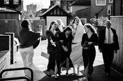 Bride and her bridesmaids singing as they walk to church