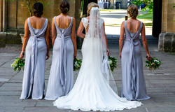 The bride and bridesmaids posing at the incredible Trinity College Oxford