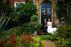 The bride and groom share a quiet moment in the gardens of Lady Margaret Hall