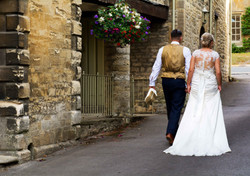 Bride and groom going for a walk at Bay Tree Hotel