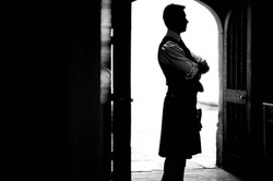 Stunning silhouette of the bestman at Trinity College, Oxford