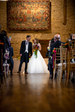 Walking down the aisle as a married couple at The Great Barn Aynho