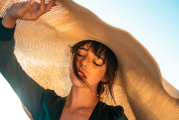 Lady at Beach with Hat.jpg