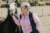 WOMAN PETTING HORSE.jpg