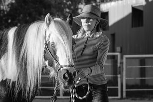 Woman leading a horse during equine assisted psychotherapy at Medicine Horse in Boulder, Colorado.