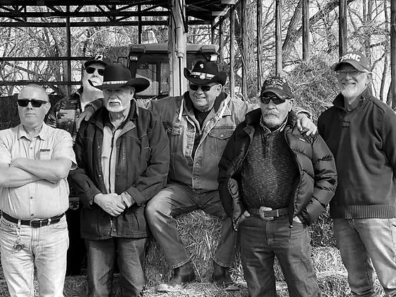 Black & white photograph of six veterans from our Operation Be Herd therapy group.
