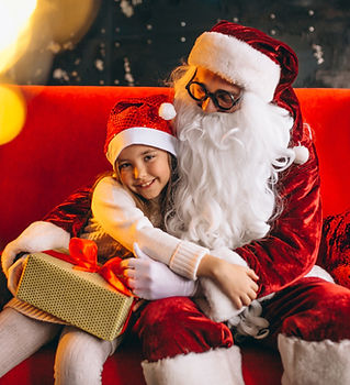 little-girl-sitting-with-santa-presents-