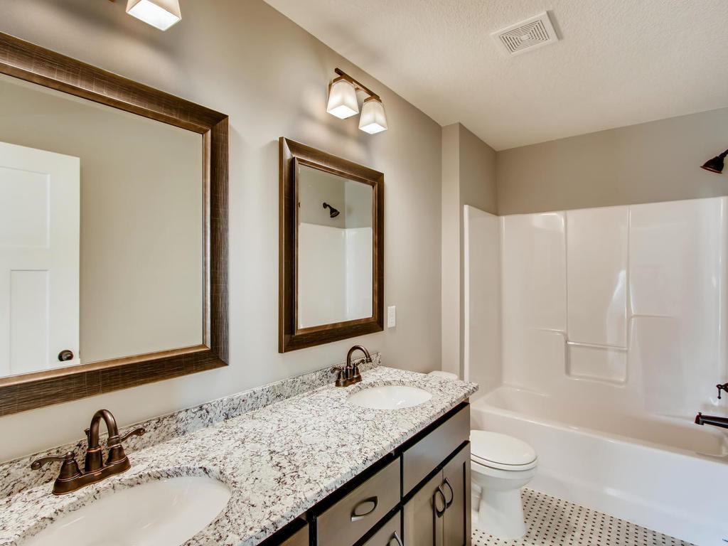 Upper main bath - granite countertops and dual sinks