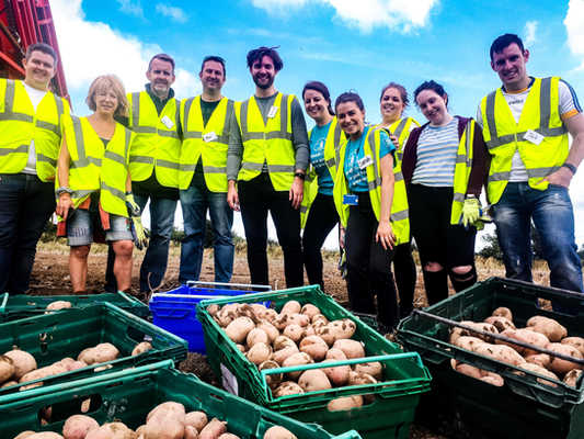 AIB VOLUNTEERS WITH GLEANED PRODUCE 2019
